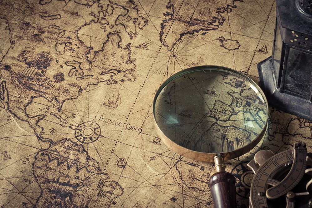 Magnifying glass on an old map