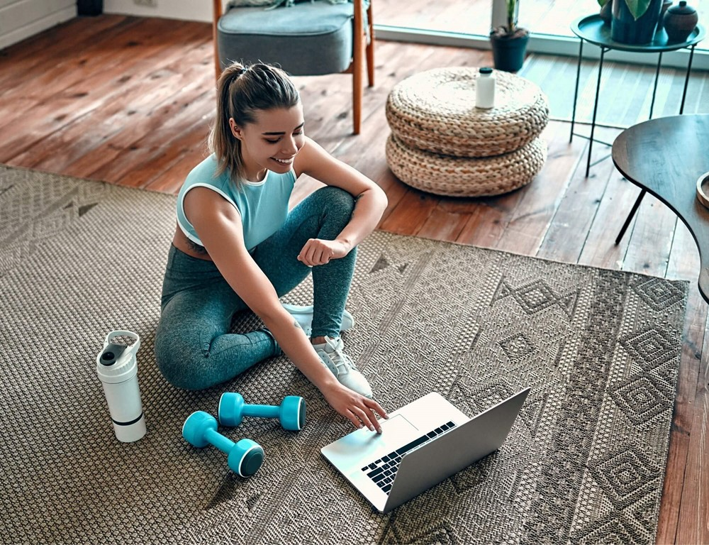 Woman using a computer for online fitness