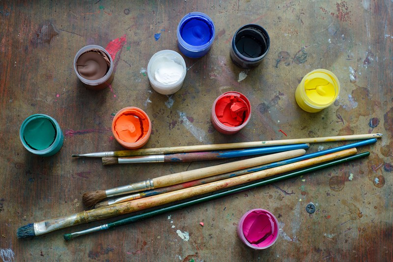 Brushes with tubs of coloured paint