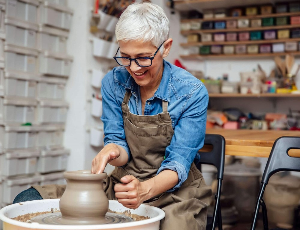 Lady using a pottery wheel